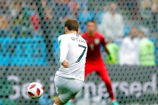(AP Photo/Ricardo Mazalan). France's Antoine Griezmann scores his side's second goal during the quarterfinal match between Uruguay and France at the 2018 soccer World Cup in the Nizhny Novgorod Stadium, in Nizhny Novgorod, Russia, Friday, July 6, 2018.