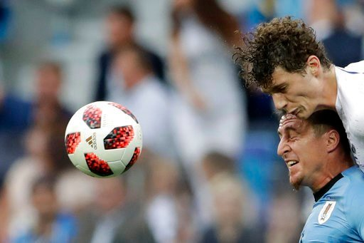 (AP Photo/Petr David Josek). France's Benjamin Pavard, top, and Uruguay's Cristian Rodriguez challenge for the ball during the quarterfinal match between Uruguay and France at the 2018 soccer World Cup in the Nizhny Novgorod Stadium, in Nizhny Novgorod...