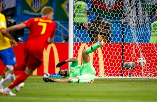 (AP Photo/Francisco Seco). Brazil goalkeeper Alisson sits on the pitch after Belgium's Kevin De Bruyne, left, scored his side's second goal during the quarterfinal match between Brazil and Belgium at the 2018 soccer World Cup in the Kazan Arena, in Kaz...