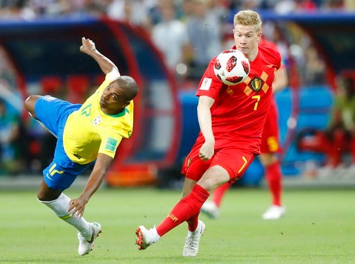 (AP Photo/Frank Augstein). Brazil's Fernandinho, left, and Belgium's Kevin De Bruyne challenge for the ball during the quarterfinal match between Brazil and Belgium at the 2018 soccer World Cup in the Kazan Arena, in Kazan, Russia, Friday, July 6, 2018.
