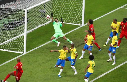(AP Photo/Thanassis Stavrakis). Brazil goalkeeper Alisson, center, fails to stop Belgium's first goal during the quarterfinal match between Brazil and Belgium at the 2018 soccer World Cup in the Kazan Arena, in Kazan, Russia, Friday, July 6, 2018.