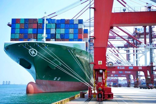 (Chinatopix via AP). A ship hauls containers at a container port in Qingdao in eastern China's Shandong province Friday, July 6, 2018. The United States hiked tariffs on Chinese imports Friday and Beijing said it immediately retaliated in a dispute bet...
