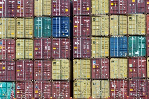 """(AP Photo/Stephen B. Morton). In this Thursday, July, 5, 2018 photo, a bay of 40-foot shipping container fill the stern of a container ship at the Port of Savannah in Savannah, Ga. The United States and China launched what Beijing called the """"biggest t..."""