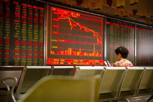 (AP Photo/Mark Schiefelbein). A Chinese investor uses her smartphone as she monitors stock prices at a brokerage house in Beijing, Friday, July 6, 2018. President Donald Trump made clear Thursday that U.S. tariffs against Chinese imports will take effe...