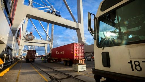 (AP Photo/Stephen B. Morton). In this Thursday, July, 5, 2018 photo, Jockey trucks line up to under massive post-Panamax cranes to unload their 40-foot shipping container at the Port of Savannah in Savannah, Ga. The United States and China launched wha...
