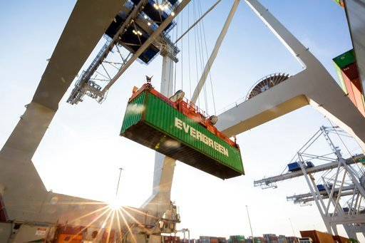 (AP Photo/Stephen B. Morton). In this June, 19, 2018 photo, a ship to shore crane lifts a 40-foot Evergreen Line shipping container off a jockey truck onto a container ship at the Port of Savannah in Savannah, Ga. The U.S. has threatened to impose 25 p...