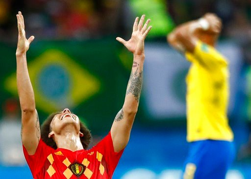 (AP Photo/Matthias Schrader). Belgium's Axel Witsel, centre celebrates after the final whistle as Belgium defeat Brazil in their quarterfinal match between Brazil and Belgium at the 2018 soccer World Cup in the Kazan Arena, in Kazan, Russia, Friday, Ju...