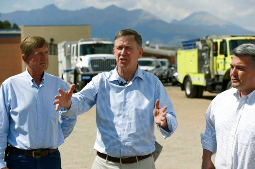(Andy Cross /The Denver Post via AP). Colorado Gov. John Hickenlooper, center, discusses the Spring Creek Fire during a press conference on the Sierra Grande School grounds along with U.S. Rep. Scott Tipton, R-Colo., left, and U.S. Sen. Cory Gardner, R...