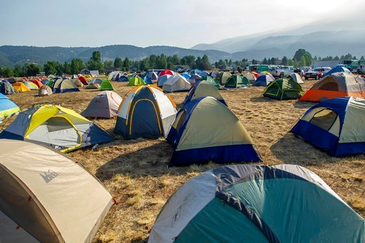 (Anna Stonehouse/The Aspen Times via AP). Tents are set up for the firefighters fighting a wildfire at the Crown Mountain Park Friday, July 6, 2018, in El Jebel, Colo.