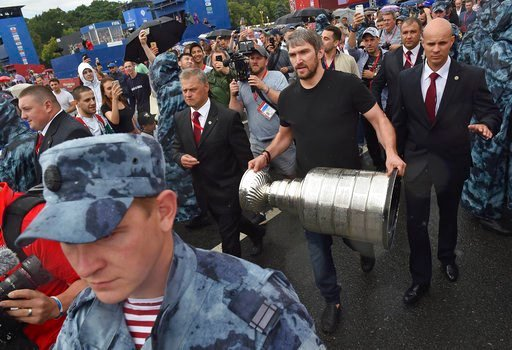 (AP Photo/Dmitry Serebryakov). Washington Capitals Alex Ovechkin, from Russia, holds the Stanley Cup trophy at the fan zone in Moscow ahead of the the quarterfinal match between Russia and Croatia at the 2018 soccer World Cup that is being played in th...