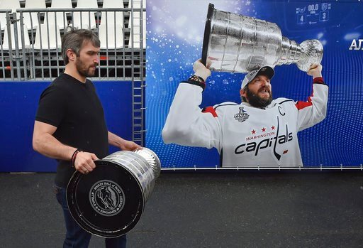(AP Photo/Dmitry Serebryakov). Washington Capitals Alex Ovechkin, from Russia, carries the Stanley Cup trophy at the fan zone in Moscow ahead of the the quarterfinal match between Russia and Croatia at the 2018 soccer World Cup that is being played in ...