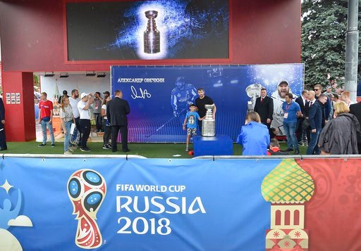 (AP Photo/Dmitry Serebryakov). Washington Capitals Alex Ovechkin, from Russia, center, poses with the Stanley Cup trophy in the fan zone in Moscow ahead of the the quarterfinal match between Russia and Croatia at the 2018 soccer World Cup that is being...