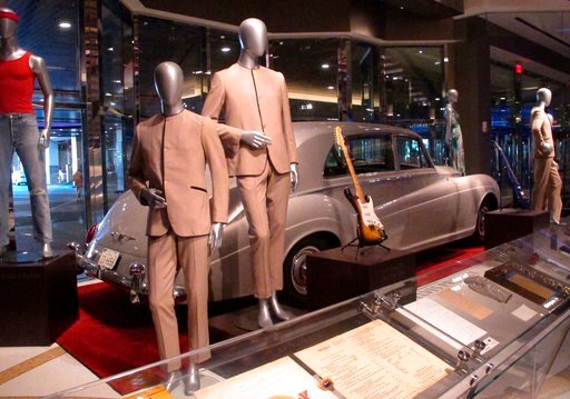 (AP Photo/Wayne Parry). This July 5, 3018 photo shows suits worn by the Beatles during an early tour of America in front of the Rolls Royce automobile owned by Elvis Presley, part of a large collection of music memorabilia on display at the Hard Rock c...