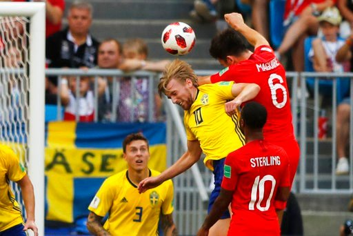 (AP Photo/Frank Augstein). England's Harry Maguire, right above, scores his side's opening goal during the quarterfinal match between Sweden and England at the 2018 soccer World Cup in the Samara Arena, in Samara, Russia, Saturday, July 7, 2018.