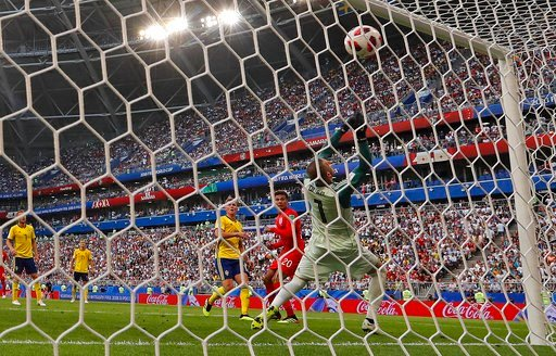 (AP Photo/Frank Augstein). England's Dele Alli, second right, scores his side's second goal during the quarterfinal match between Sweden and England at the 2018 soccer World Cup in the Samara Arena, in Samara, Russia, Saturday, July 7, 2018.