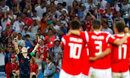 (AP Photo/Rebecca Blackwell). Croatia's Luka Modric, left, celebrates after scores penalty shootout during the quarterfinal match between Russia and Croatia at the 2018 soccer World Cup in the Fisht Stadium, in Sochi, Russia, Saturday, July 7, 2018.