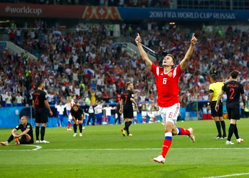 (AP Photo/Pavel Golovkin). Russia's Denis Cheryshev celebrates after scoring his side's first goal during the quarterfinal match between Russia and Croatia at the 2018 soccer World Cup in the Fisht Stadium, in Sochi, Russia, Saturday, July 7, 2018.