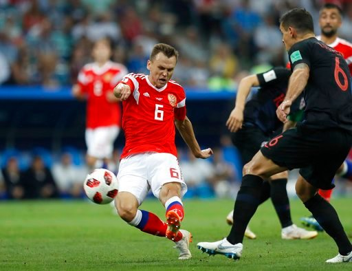 (AP Photo/Pavel Golovkin). Russia's Denis Cheryshev scores his side's opening goal during the quarterfinal match between Russia and Croatia at the 2018 soccer World Cup in the Fisht Stadium, in Sochi, Russia, Saturday, July 7, 2018.