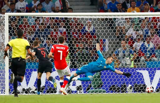 (AP Photo/Rebecca Blackwell). Croatia's Andrej Kramaric, second left, scores his side's opening goal during the quarterfinal match between Russia and Croatia at the 2018 soccer World Cup in the Fisht Stadium, in Sochi, Russia, Saturday, July 7, 2018.