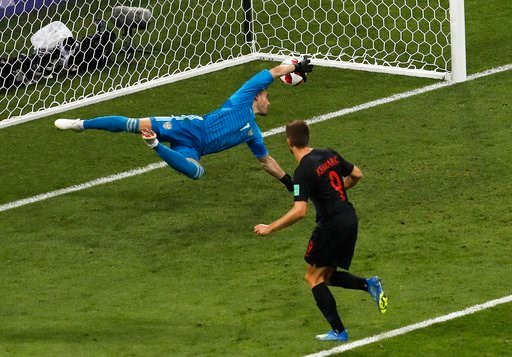 (AP Photo/Alexander Zemlianichenko). Croatia's Andrej Kramaric, right, scores his side's first goal during the quarterfinal match between Russia and Croatia at the 2018 soccer World Cup at the Fisht Stadium in Sochi, Russia, Saturday, July 7, 2018.