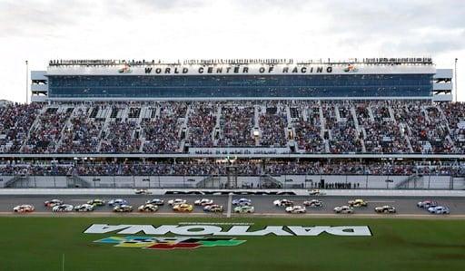 (AP Photo/John Raoux). Chase Elliott, left, leads the field of cars to start the NASCAR Cup Series auto race at Daytona International Speedway, Saturday, July 7, 2018, in Daytona Beach, Fla.
