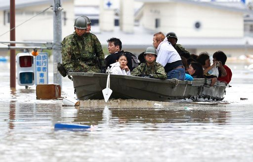 (Takumi Sato/Kyodo News via AP). Japan Ground Self-Defense Force members use a boat to evacuate residents from a flooded area caused by heavy rains in Kurashiki, Okayama prefecture, southwestern Japan, Saturday, July 7, 2018. Torrents of rainfall and f...