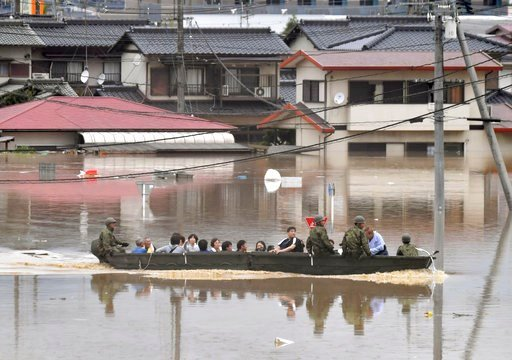 (Koki Sengoku/Kyodo News via AP). Japan Ground Self-Defense Force members use a boat to evacuate residentd from a flooded area caused by heavy rains in Kurashiki, Okayama prefecture, southwestern Japan, Saturday, July 7, 2018. Torrents of rainfall and ...