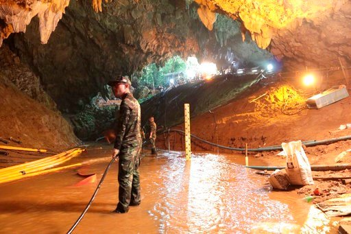 (Royal Thai Navy via AP). In this undated photo released by Royal Thai Navy on Saturday, July 7, 2018, Thai rescue teams arrange water pumping system at the entrance to a flooded cave complex where 12 boys and their soccer coach have been trapped.