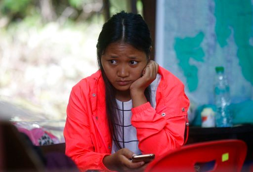 (AP Photo/Sakchai Lalit). A family member sits in tent near a cave where 12 boys and their soccer coach have been trapped since June 23, in Mae Sai, Chiang Rai province, in northern Thailand Saturday, July 7, 2018.