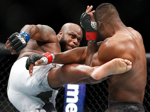 (AP Photo/John Locher). Derrick Lewis kicks Francis Ngannou during a heavyweight mixed martial arts bout at UFC 226, Saturday, July 7, 2018, in Las Vegas.