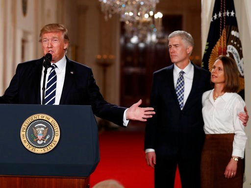 (AP Photo/Carolyn Kaster, File). FILE - In this Jan. 31, 2017, file photo, President Donald Trump speaks in the East Room of the White House in Washington, to announce Judge Neil Gorsuch, standing with his wife Louise, as his nominee for the Supreme Co...