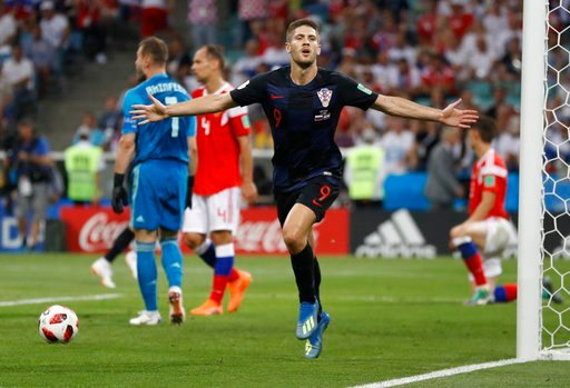 (AP Photo/Darko Bandic). Croatia's Andrej Kramaric celebrates his side's opening goal during the quarterfinal match between Russia and Croatia at the 2018 soccer World Cup in the Fisht Stadium, in Sochi, Russia, Saturday, July 7, 2018.