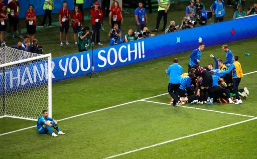 (AP Photo/Alexander Zemlianichenko). Russia goalkeeper Igor Akinfeev, left, reacts as Croatia players celebrate after scoring the winning penalty during the quarterfinal match between Russia and Croatia at the 2018 soccer World Cup at the Fisht Stadium...