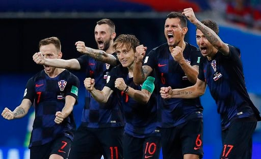 (AP Photo/Manu Fernandez). Croatia national soccer team players celebrate after a penalty is saved in a shootout during the quarterfinal match between Russia and Croatia at the 2018 soccer World Cup in the Fisht Stadium, in Sochi, Russia, Saturday, Jul...