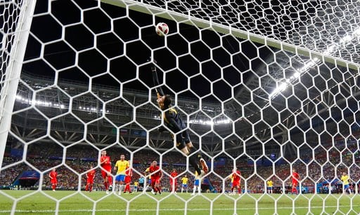 (AP Photo/Frank Augstein). Belgium goalkeeper Thibaut Courtois saves from Brazil's Neymar during the quarterfinal match between Brazil and Belgium at the 2018 soccer World Cup in the Kazan Arena, in Kazan, Russia, Friday, July 6, 2018.