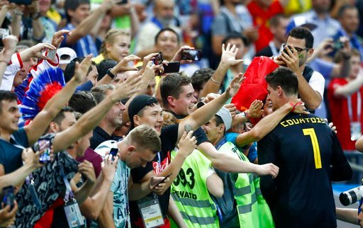 (AP Photo/Matthias Schrader). Belgium goalkeeper Thibaut Courtois celebrates with his teams fans after defeating Brazil in their quarterfinal match between Brazil and Belgium at the 2018 soccer World Cup in the Kazan Arena, in Kazan, Russia, Friday, Ju...