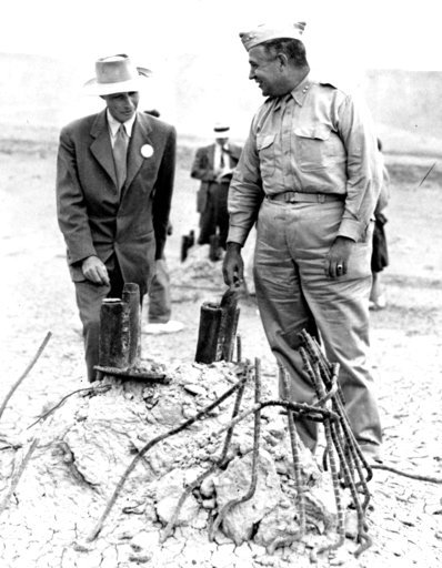 (AP Photo/File). FILE - This Sept. 9, 1945, file photo Gen. Leslie R. Groves, right, and Dr. J. Robert Oppenheimer, who cooperated on the development of the atomic bomb, survey the area in Alamogordo, N.M., where a tower once stood before the test bomb...