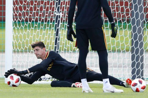 (AP Photo/David Vincent). Belgium's goalkeeper Thibaut Courtois cathces the ball during a training session at the 2018 soccer World Cup in Dedovsk, Russia, Sunday, July 8, 2018.
