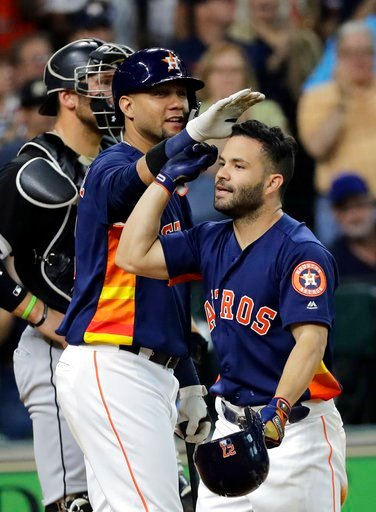 (AP Photo/David J. Phillip). Houston Astros' Jose Altuve, right, is congratulated by Yuli Gurriel after hitting a home run against the Chicago White Sox during the fourth inning of a baseball game Sunday, July 8, 2018, in Houston.