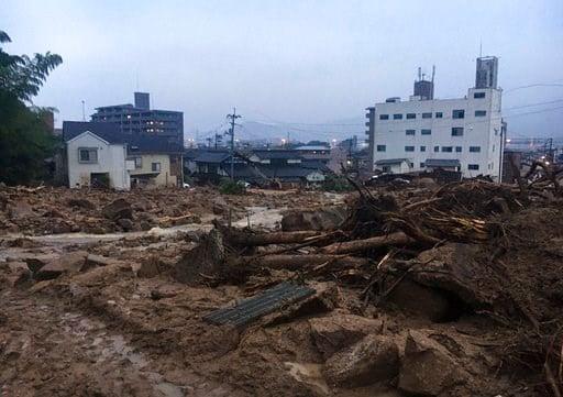 (AP Photo Haruka Nuga). Debris fills a small village following heavy rains Sunday, July 8, 2018, in Kuchita-Minami, Asakita-ku, Hiroshima, Japan. Searches continued Sunday night for dozens of victims still missing from the heavy rainfall that hammered ...