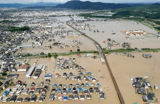 (Shohei Miyano/Kyodo News via AP). Houses are partly submerged in water, following heavy rain in Kurashiki city, Okayama prefecture, southwestern Japan, Sunday, July 8, 2018. Heavy rainfall hammered southern Japan for the third day, prompting new disas...