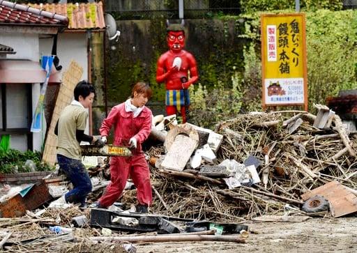 (Koki Sengoku/Kyodo News via AP). Residents clean up near a house damaged by heavy rain in Soja city, Okayama prefecture, southwestern Japan, Sunday, July 8, 2018. Heavy rainfall hammered southern Japan for the third day, prompting new disaster warning...