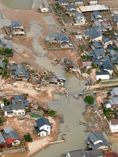 (Kyodo News via AP). This photo shows an submerged housing area in Kurashiki, Okayama prefecture, western Japan Monday, July 9, 2018. People prepared for risky search and cleanup efforts in southwestern Japan on Monday, where several days of heavy rain...