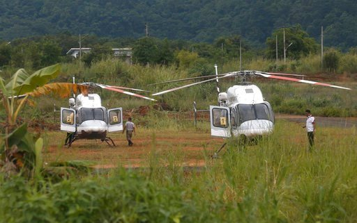 (AP Photo/Sakchai Lalit). Two helicopters wait near the cave for more evacuations of the boys and their soccer coach who have been trapped since June 23, in Mae Sai, Chiang Rai province, northern Thailand Monday, July 9, 2018.