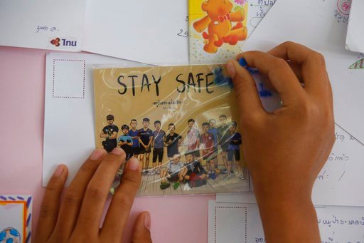 (AP Photo/Sakchai Lalit). A Thai well wisher puts a poster to pray for boys and their soccer coach who have been trapped since June 23, in Mae Sai, Chiang Rai province, northern Thailand Monday, July 9, 2018.