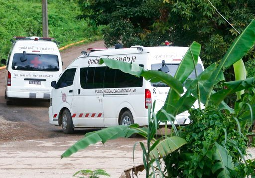 (AP Photo/Sakchai Lalit). Two ambulances arrive near the cave to wait for more evacuations of the boys and their soccer coach who have been trapped since June 23, in Mae Sai, Chiang Rai province, northern Thailand Monday, July 9, 2018.