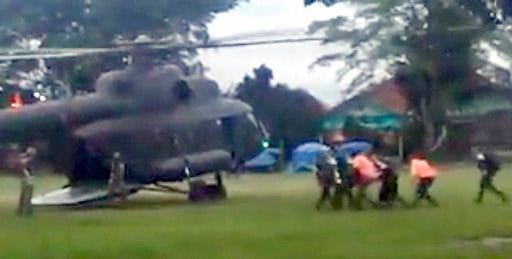 (Big Krean via AP). In this image made from video taken Sunday, July 8, 2018, an emergency team carries a stretcher believed to be carrying one of the rescued boys from the flooded cave to a waiting helicopter in Mae Sai, Chiang Mai province, northern ...