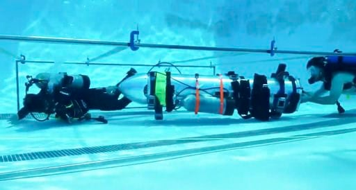 "(Courtesy of Elon Musk via AP). This frame grab from video tweeted by Elon Musk shows a ""tiny kid-sized submarine"" being tested in a pool at Palisades Charter High School, Sunday, July 8, 2018, in Pacific Palisades, Calif. Musk's Space X rocket company..."