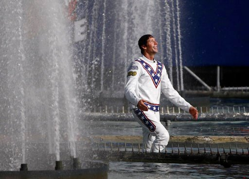 (AP Photo/John Locher). Travis Pastrana celebrates in the fountain at Caesars Palace after jumping it on a motorcycle Sunday, July 8, 2018, in Las Vegas. Pastrana recreated three of Evel Knievel's iconic motorcycle jumps on Sunday, including the leap o...