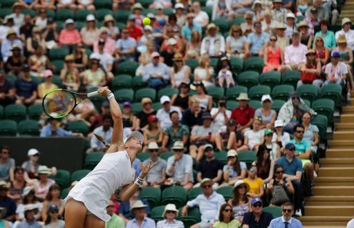 (AP Photo/Ben Curtis). Kiki Bertens of the Netherlands serves to Karolina Pliskova of the Czech Republic during their women's singles match on the seventh day at the Wimbledon Tennis Championships in London, Monday July 9, 2018.